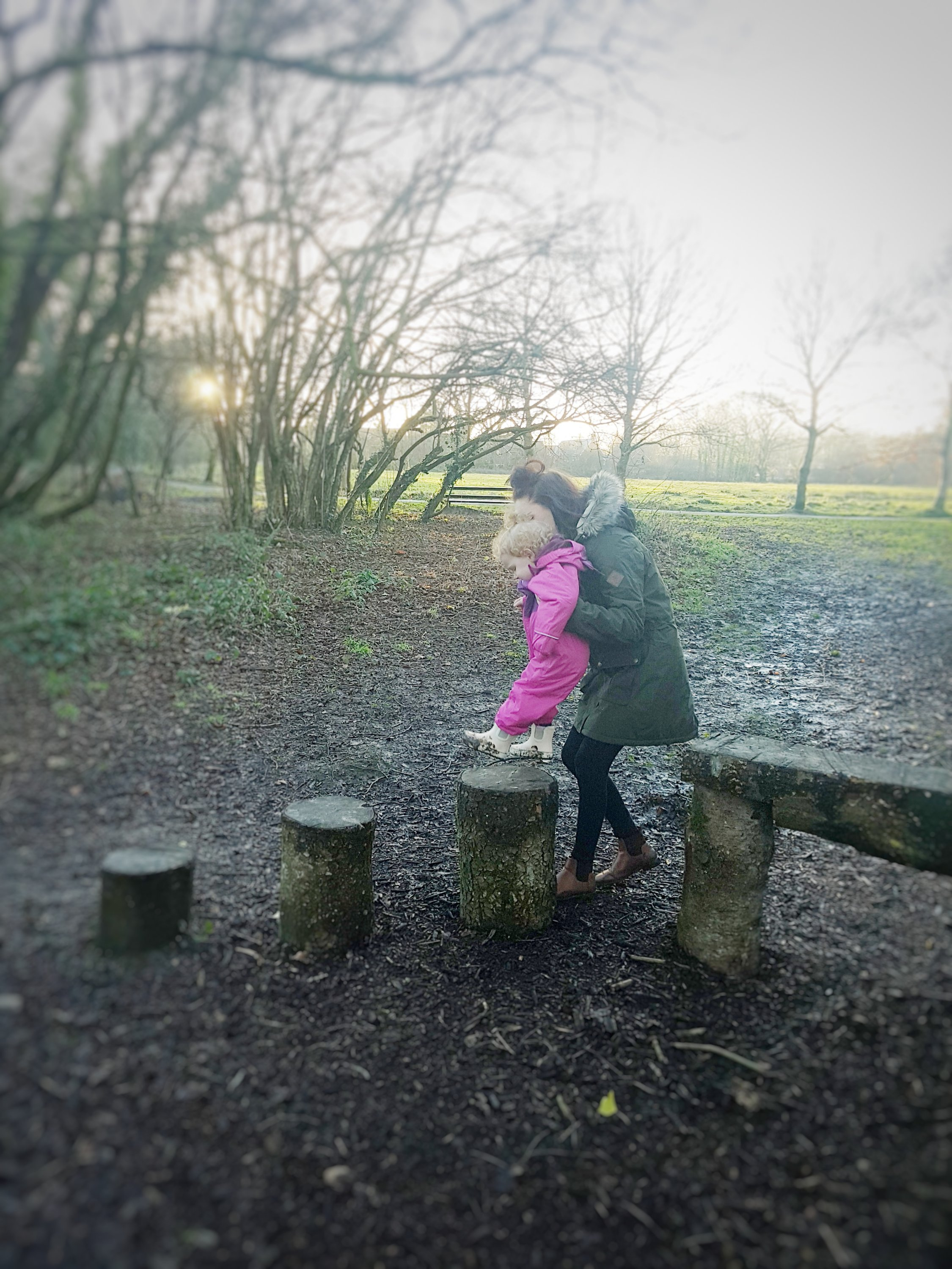 Mummy & Alyssia walking across the stepping stones!