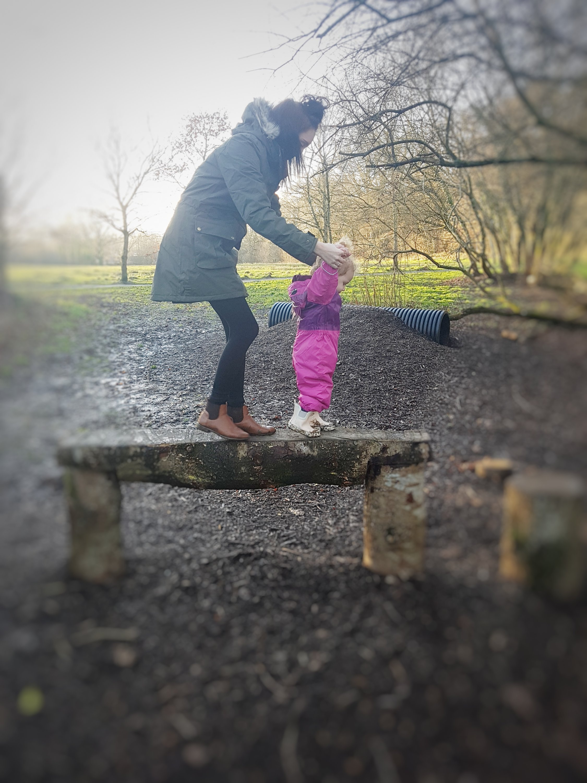 Mummy & Alyssia walking along the bench.
