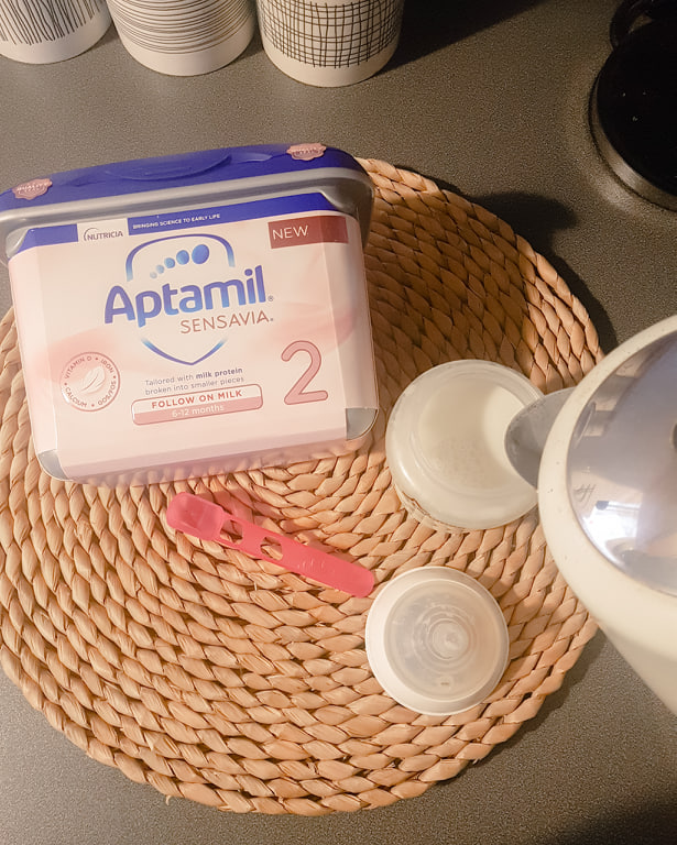 Preparing a Bottle of Aptamil Sensavia Follow On Milk with a Kettle